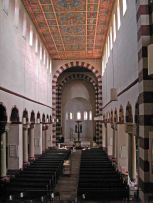 St. Michael's Church in Hildesheim, Germany. The striped bands on the arches are extremely common in Romanesque churches. The painted ceiling has been well-preserved.