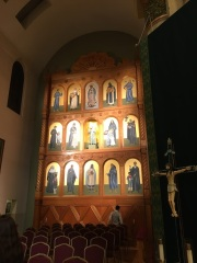 Main retablo in bad lighting. All the chairs are in the foreground because of the concelebrated Mass.