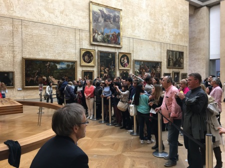 Crowds gathered around the Mona Lisa at the Musee du Louvre in Paris. Photo by Patrick Murray.