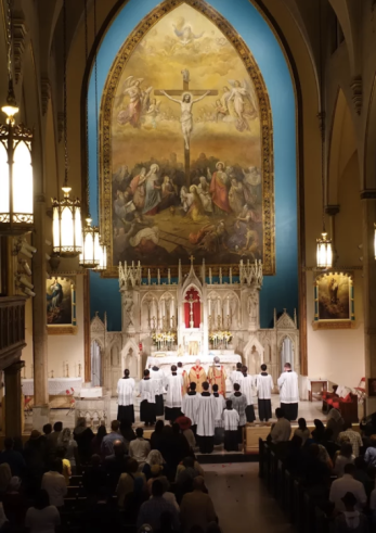 Holy Innocents (Manhattan, NYC). View of sanctuary with colossal Crucifixion scene by Constantino Brumidi. Photo from parish website.