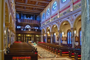 St. Anthony Cathedral Basilica (Beaumont, TX). View of nave toward rear. Photo from Beaumont Visitors' Board website.